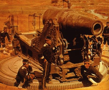 A group of soldiers surrounding a canon.